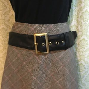 Christian Siriano black belt with gold buckle